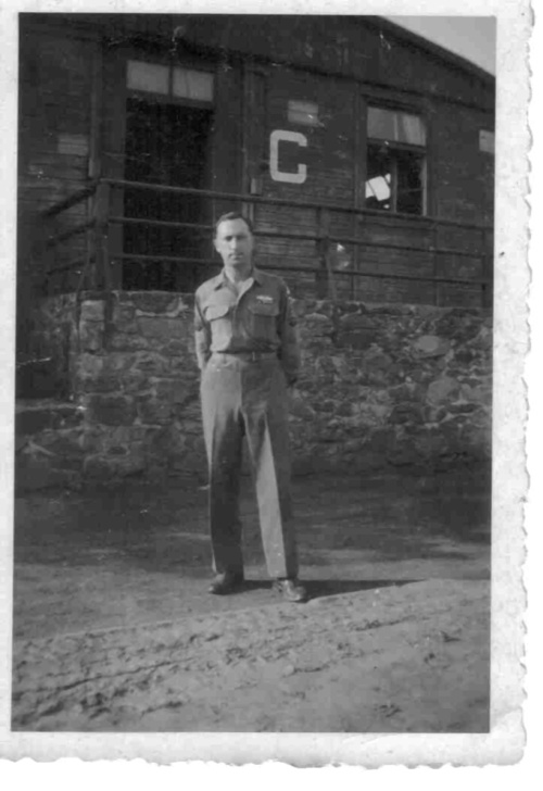 My dad in front of his Barracks in July,1945